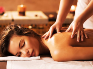 girl lying on table getting mobile massage with hands massaging her back
